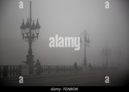 Fog pont de Pierre, stone bridge, Garonne river Bordeaux. Gironde Aquitaine France - Stock Photo