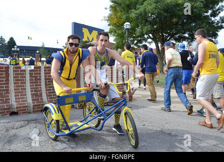 ANN ARBOR, MI - SEPTEMBER 26: University of Michigan football fans pose with their Champion's Chariot outside the - Stock Photo