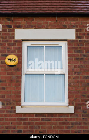 Yale alarm and window on a new house build. Bicester, Oxfordshire, England - Stock Photo
