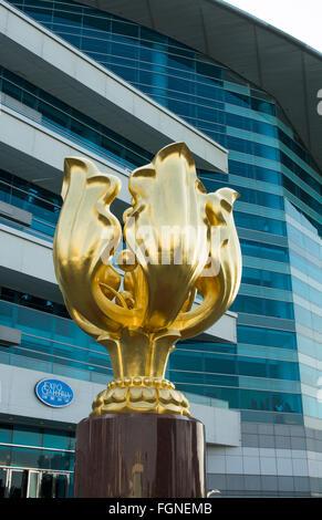 Hong Kong China Golden Bauhinia statue for the handover of Hong Kong from UK to China at the Hong Kong Convention - Stock Photo