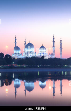 Sheikh Zayed Grand Mosque in Abu Dhabi, UAE at sunrise - Stock Photo