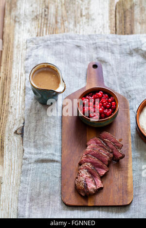 Venison, chestnut puree and lingonberries - Stock Photo