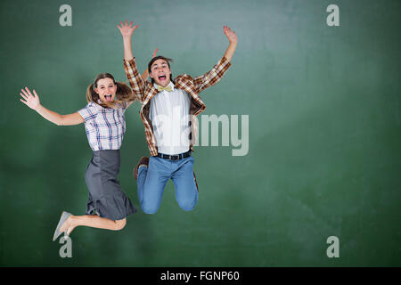 Composite image of geeky hipsters jumping and smiling - Stock Photo