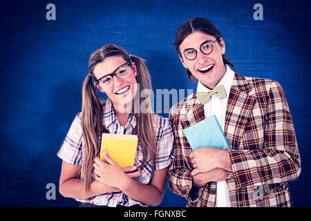 Composite image of geeky hipsters smiling at camera - Stock Photo