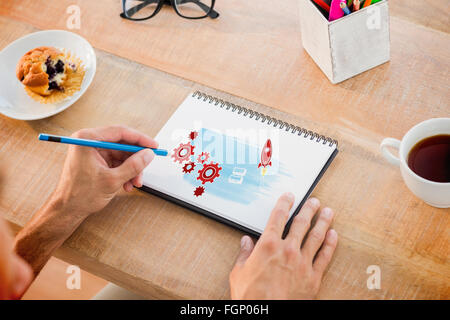 Composite image of man writing notes on notebook - Stock Photo