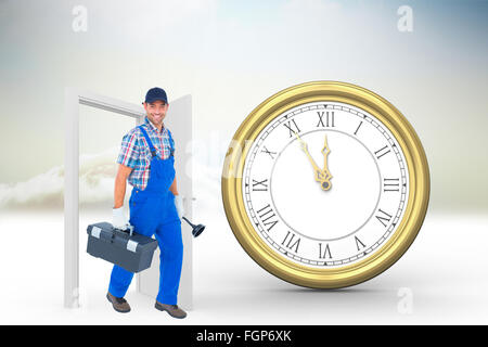 Composite image of happy plumber with plunger and toolbox walking on white background - Stock Photo
