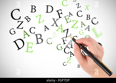 Composite image of businesswomans hand writing with fountain pen - Stock Photo