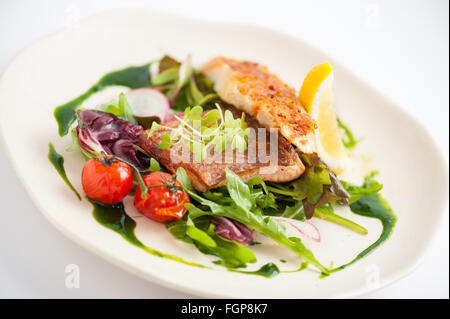 Modern style clean food, grilled salmon with toast and salad dressed with green sauce - Stock Photo