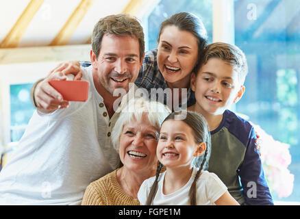 Multi-generation family taking selfie - Stock Photo