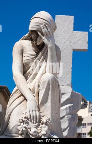 Statue sculpture on grave at Colon Cemetery, Havana, Cuba, West Indies, Caribbean, Central America - Stock Photo