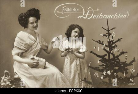Christmas, Christmas Eve, mother and daughter, Christmas tree, Merry Christmas, postcard, Germany, circa 1912, Additional - Stock Photo
