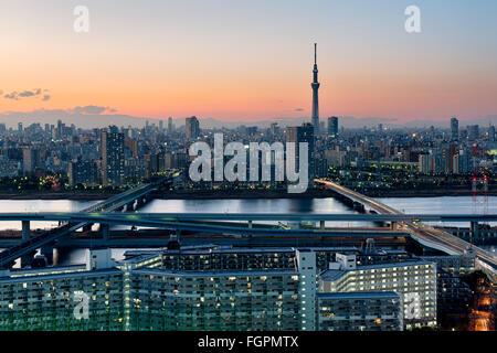 Tokyo; Japan -January 10; 2016: Tokyo Skyline at dusk, view of Asakusa district and the Sumida River. Skytree visible - Stock Photo