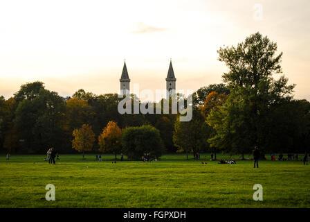 View of Ludwigskirche church in Munich from the Englischer Garten in autumn - Stock Photo