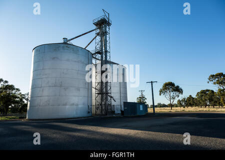 Grain silos set against a blue sky - Stock Photo