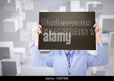 Composite image of businessman showing board - Stock Photo