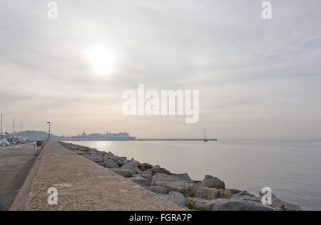 Morning sun at the harbor pier across the bay on December 17, 2015 in Ibiza, Balearic islands, Spain. - Stock Photo