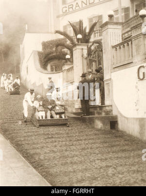 geography / travel, Portugal, isle Madeira, people, tourists are pushed along the street in a sledge, Funchal, 1936, - Stock Photo