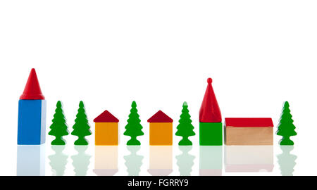 small village in colorful wooden blocks with church and trees isolated over white background - Stock Photo
