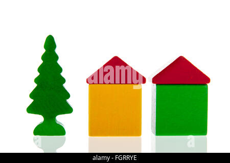 small village in colorful wooden blocks with houses and tree isolated over white background - Stock Photo