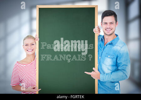 Composite image of man and woman showing card - Stock Photo