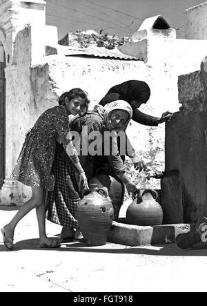 geography / travel, Greece, people, women and young girl at fountain, Rhodes, 1950s / 1960s , Additional-Rights - Stock Photo