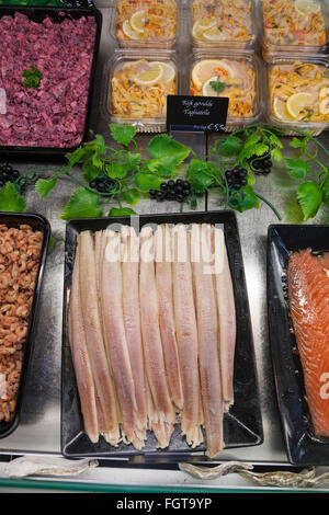 Fresh fish filling on display in chiller cabinet, for sale in a fish monger / sandwich shop. Amsterdam. Holland - Stock Photo