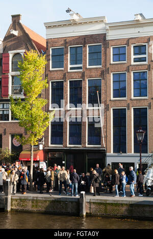 Tourist / tourists / visitors in front of Anne Frank 's House / museum in Amsterdam, Holland. The Netherlands. - Stock Photo