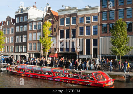 Tourist sight seeing boat with tourists / visitors in front of Anne Frank 's House / museum in Amsterdam Holland - Stock Photo