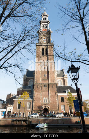 Westerkerk is a Reformed church within Dutch Protestant church. Canal - side / west  side in Amsterdam, the Netherlands. - Stock Photo