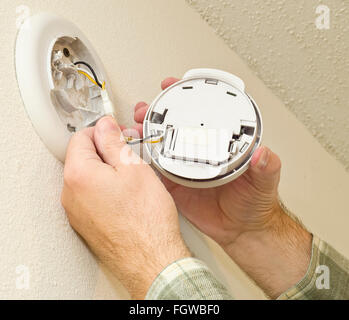 Removing Smoke Detector to Change the Battery - Stock Photo