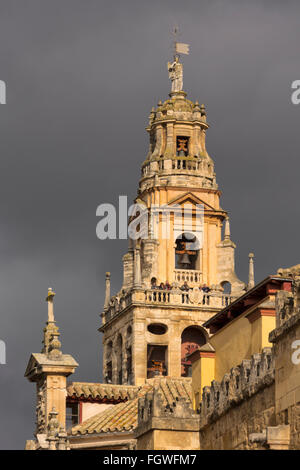 Cordoba, Cordoba Province, Andalusia, southern Spain.  The Alminar bell tower of the Cordoba mosque against a stormy - Stock Photo
