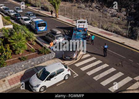 Illegally parked car being towed away. Playa San Juan, Tenerife, Canary Islands, Spain - Stock Photo