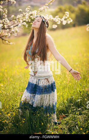 Beautiful free woman in a field. Nature and harmony - Stock Photo