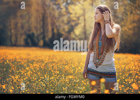 Beautiful hippie woman in flower field . Summer colors - Stock Photo