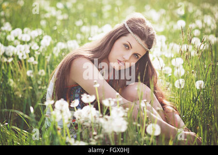 Beautiful free girl in a flowered meadow. Summer portrait - Stock Photo