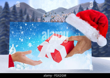 Composite image of couple holding gift - Stock Photo