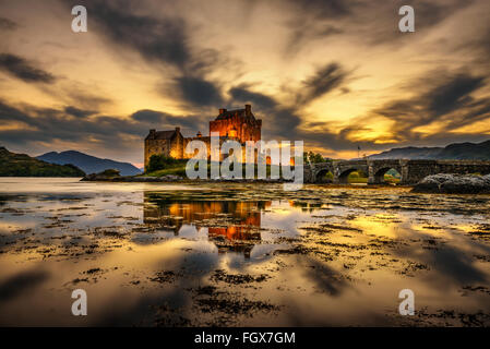 Sunset over Eilean Donan Castle, Scotland, United Kingdom. Long exposure. - Stock Photo