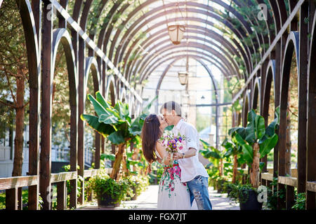 loving couple man and woman kissing in the park - Stock Photo