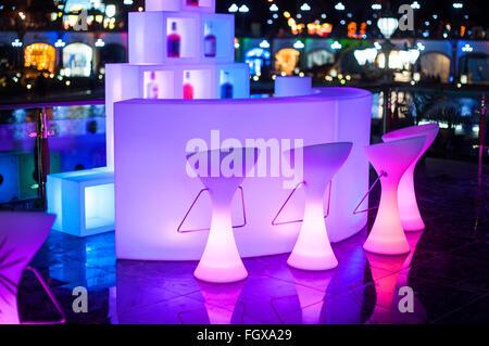 beautiful glowing Design Night Cafe in city - Stock Photo