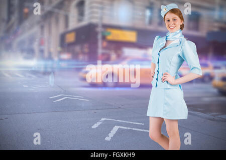 Composite image of pretty air hostess with hand on hip - Stock Photo