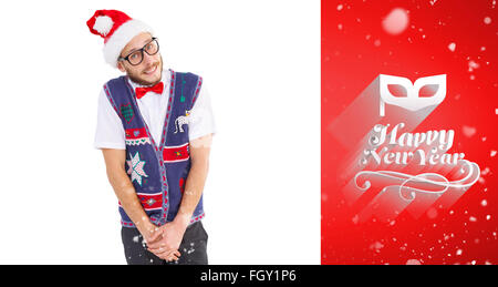 Composite image of geeky hipster in santa hat - Stock Photo