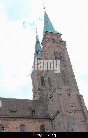 Two towers of St. Sebaldus Church (St. Sebald, Sebalduskirche) in Nuremberg, Germany - Stock Photo