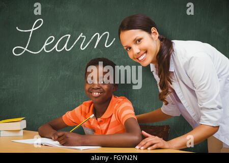 Learn against green chalkboard - Stock Photo