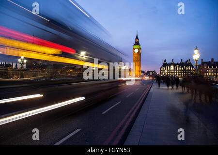 London Bus passing by on Westminster Bridge - Stock Photo