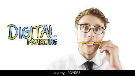 Composite image of geeky businessman biting a pencil - Stock Photo