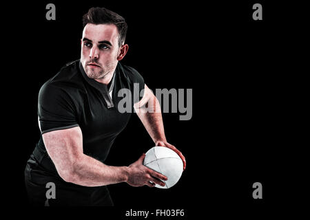 Composite image of rugby player throwing the ball - Stock Photo