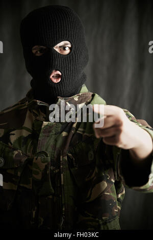 Portrait Of Terrorist Addressing Camera - Stock Photo