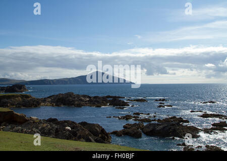 A rock foreshore on Achill island, Co. Mayo in the west of Ireland with the Atlantic and mountain in the background - Stock Photo