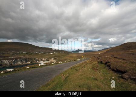 Road, Sea and Cliffs, Achill Island, Co. Mayo, Republic of Ireland - Stock Photo
