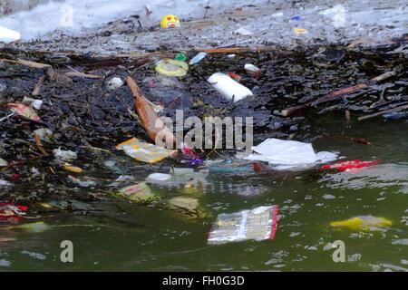 Washed up beach litter debris pollution ocean plastic plastics at Hoylake, Wallasey, UK - Stock Photo